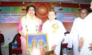9. BK Laxmiji Presenting the Godly gift