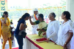 Brahma Kumaris Welcomed by applying 'Tilak' on their foreheads and greeted with flower.