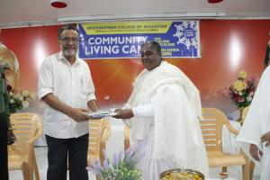 3. BK Laxmiji presented Godly gift to Dr.NK Ramakrishnan - Chairman, Sree Narayana College of Education, Mahe