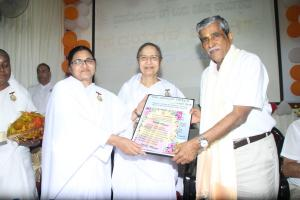 8. BK Kamalesh Behn Presenting the Godly gifts to Sri Mahendra Saliyan
