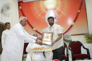 5. BK Nagaraj Brother giving the Godly gift to Guests